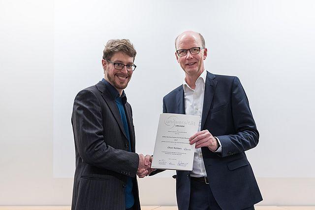 Oliver Richters und Prof. Sauerland